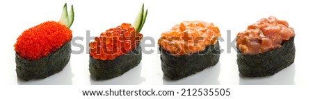 Set of four sushi with tuna, salmon caviar and spicy sauce in nori on a white background close up isolated - stock photo