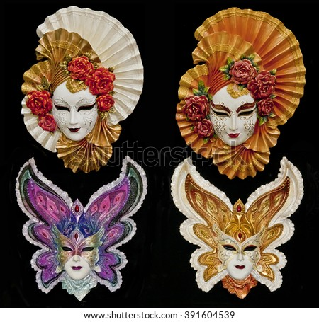 Set of four Venetian carnival masks isolated on black - stock photo