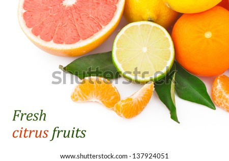 Set of fresh citrus fruits with green leaves, isolated on white background