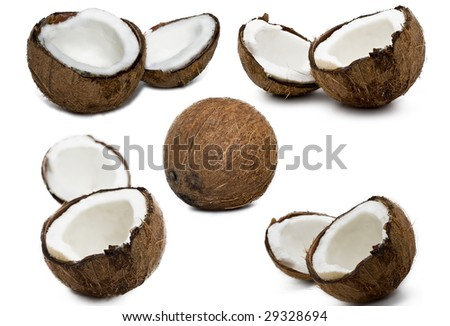 Set of fresh coconuts on white background