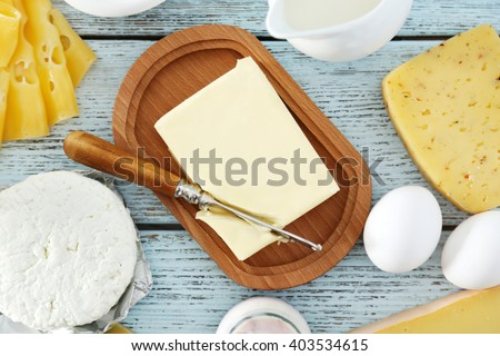 Set of fresh dairy products on blue wooden table, close up - stock photo