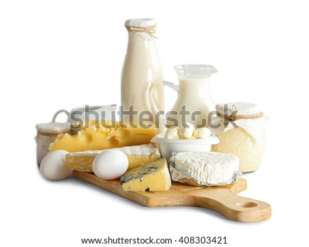 Set of fresh dairy products on wooden board,  isolated on white