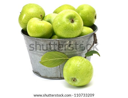 Set of fresh green apples in metallic bowl isolated on white background - stock photo