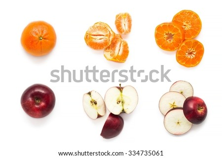 Set of fresh mandarins and apples isolated over white, top view - stock photo