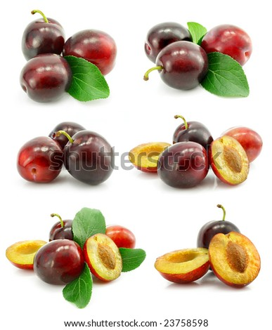set of fresh plum fruits with green leafs isolated on white background - stock photo
