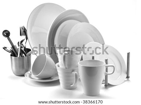 set of fresh washed plates and cutlery isolated on white - stock photo