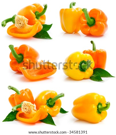 set of fresh yellow orange peppers with cut and green leaves isolated on white background - stock photo