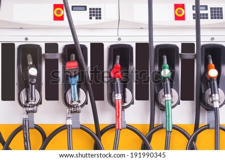 Set of fuel pump nozzles at the Gas service station. - stock photo