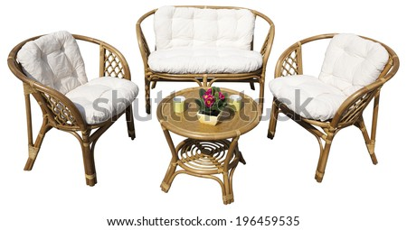 Set of furniture from rattan isolated on white background. Suitable for garden, balcony and interior. Clipping path is also included. - stock photo