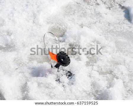 Snow tubing stock photo 19820671 shutterstock for Winter fishing gear