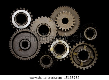Set of gears isolated on black background - stock photo