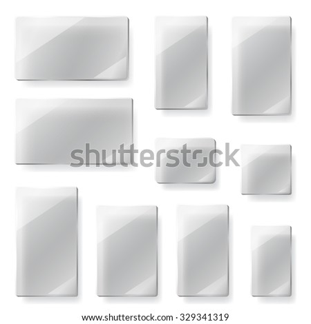 Set of glass plates of different shapes in gray colors - stock photo