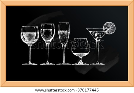 set of glasses goblets on chalkboard background.