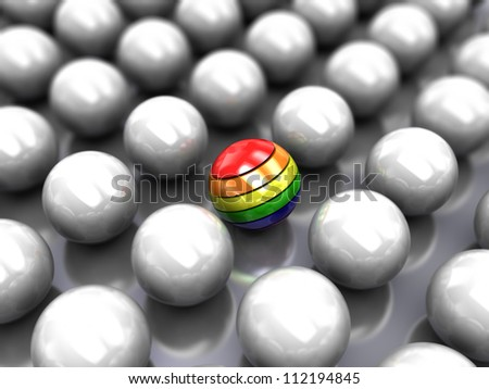 Set of glossy grey balls with colorful ball in the middle - stock photo