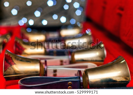 Set of gold handbells in red box with bokeh defocused blurred. Christmas time