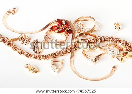 Set of gold jewelry isolated on white background - stock photo