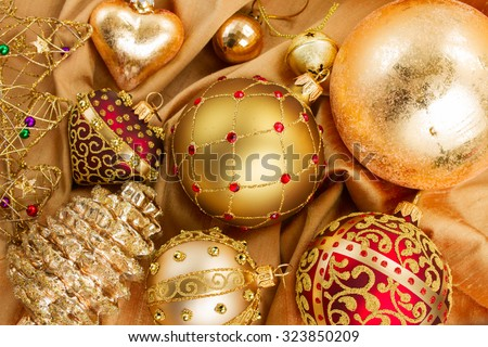 set of golden and red  christmas  decoration on soft silk background