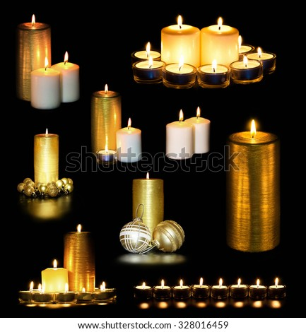 Set of Golden Christmas New Yea Candles and flame isolated on black background