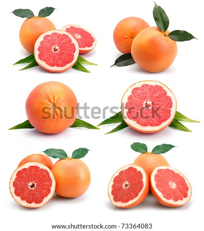 Set of grapefruit fruits with cuts and green leaf isolated on white - stock photo