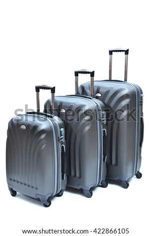 Set of gray suitcases large, medium and small isolated on white background. - stock photo