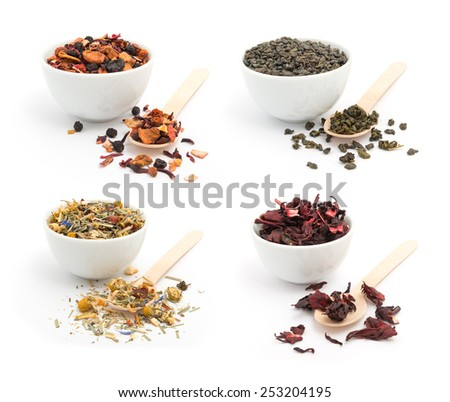 Set of green, fruit, herbal and hibiscus tea in porcelain bowls with wooden spoons on white background - stock photo