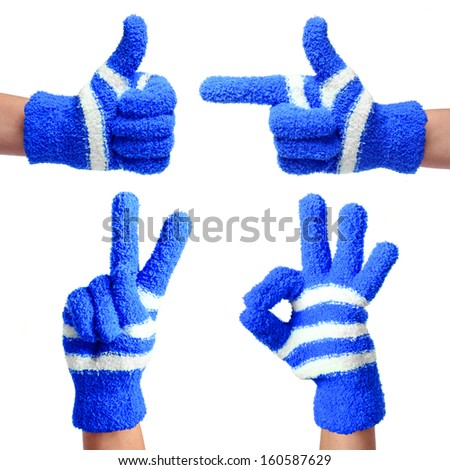 Set of Hands in Knitted Blue Gloves isolated on white. Thumb Up, Pointing, Victory, Ok Sign - stock photo