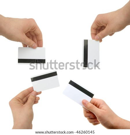 set of hands with magnetic cards - stock photo