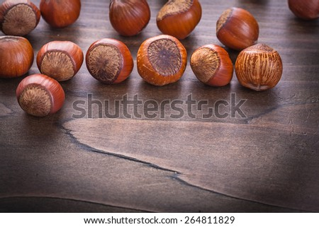 set of hazelnuts on vintage wooden board food and drink concept  - stock photo
