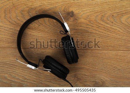 Set of headphones on a rustic wooden surface