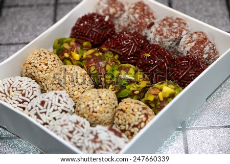 set of holiday chocolates with decoration cereals - stock photo