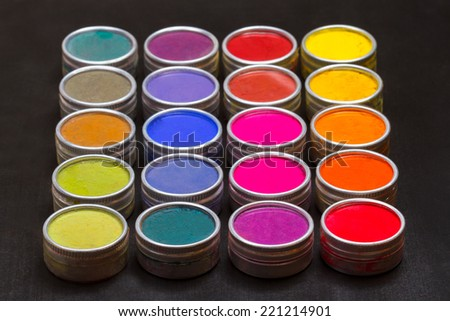 Set of Indian Holi festival colours on a black background - stock photo