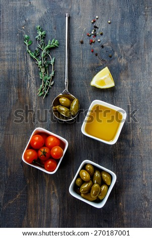 Set of ingredients and spice for cooking on dark Wooden Background. Vegetarian food, health or cooking concept. Top view. - stock photo