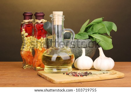 Set of ingredients and spice for cooking on wooden table on brown background
