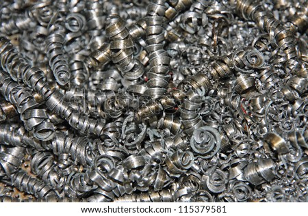 set of iron swarf after machining of some pieces of iron - stock photo