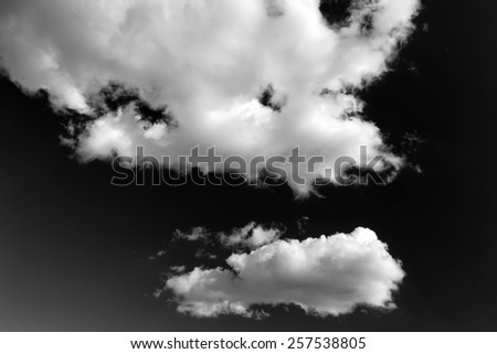 Set of isolated clouds over black