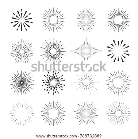 Set of isolated sunburst rays design elements on a black background.