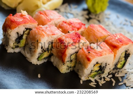set of Japanese sushi on a black plate - stock photo