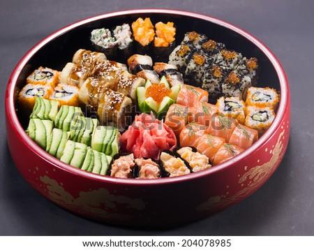 Set of Japanese sushi on the black background - stock photo