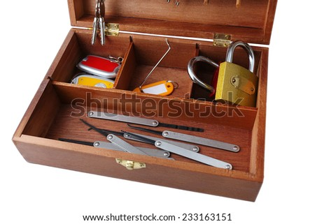 Set of keys and lock picks in wooden box isolated on white