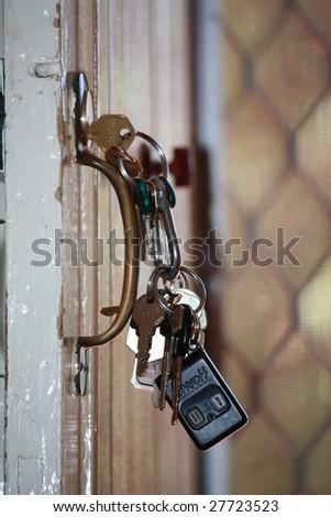 Set of keys hanging in a door - stock photo