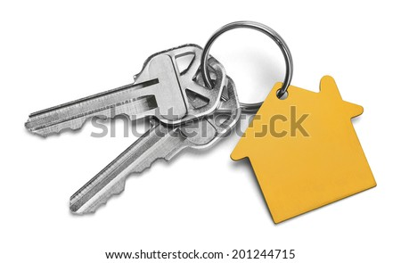 Set of Keys With Yellow House Isolated on White Background. - stock photo