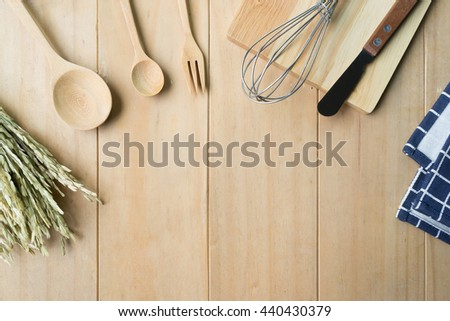 Set of kitchen utensil on wooden table .Top view with blank open notebook for copy space - stock photo