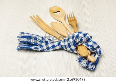 Set of kitchen utensils tied with towel - stock photo