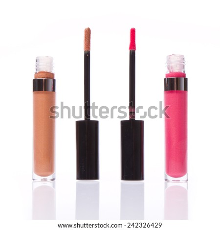 set of lip glosses isolated on white background - stock photo