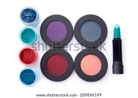 Set of loose and pressed eyeshadows, and lipstick, top view isolated on white background with shadow  - stock photo