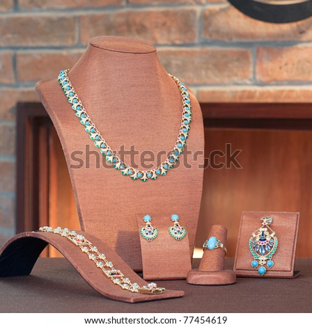 Set of luxury jewelry : necklace, pendant, earring and bracelet - stock photo