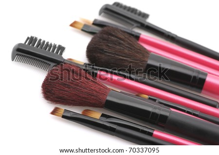 Set of make-up brushes close-up on white background.