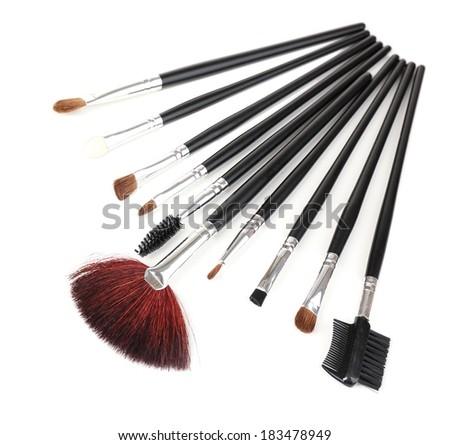 Set of make-up brushes isolated on white - stock photo