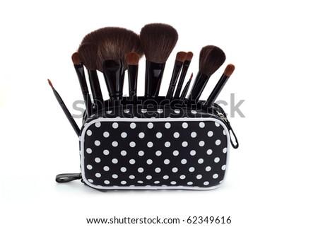 set of make-up brushes on white background - beauty treatment - stock photo