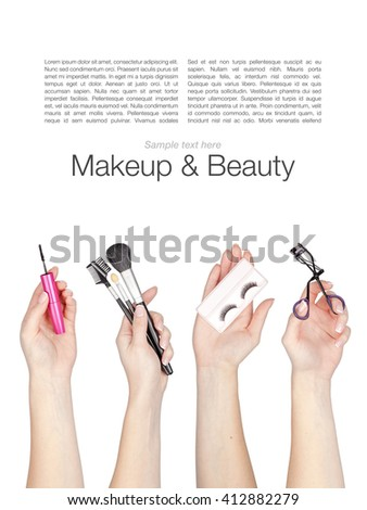 set of makeup cosmetics and brushes in a hands isolated on white background
